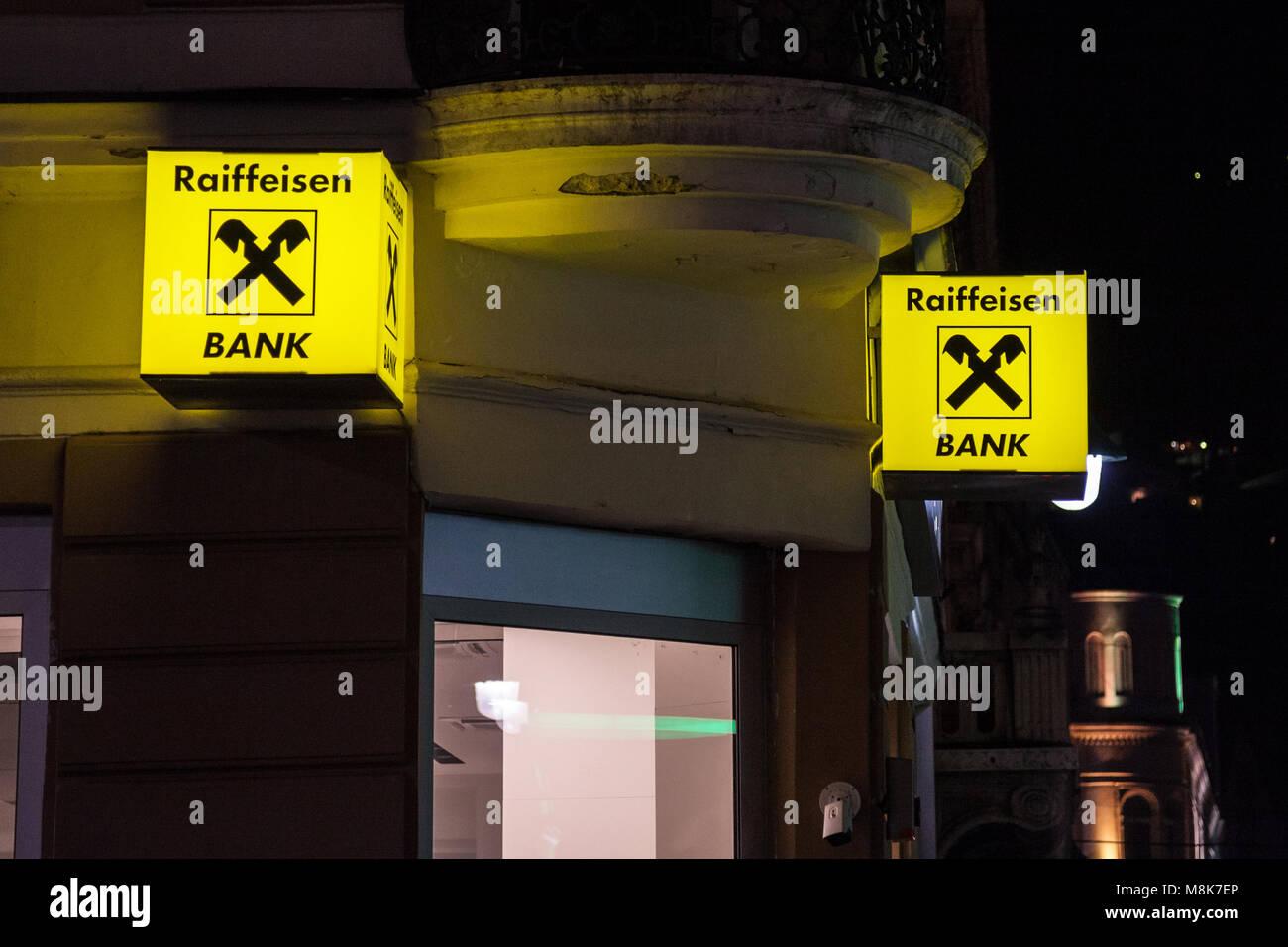 SARAJEVO, BOSNIA - FEBRUARY 17, 2018: Raiffeisen logo on their main bank in Sarajevo, taken at night. Raiffeisen - Stock Image