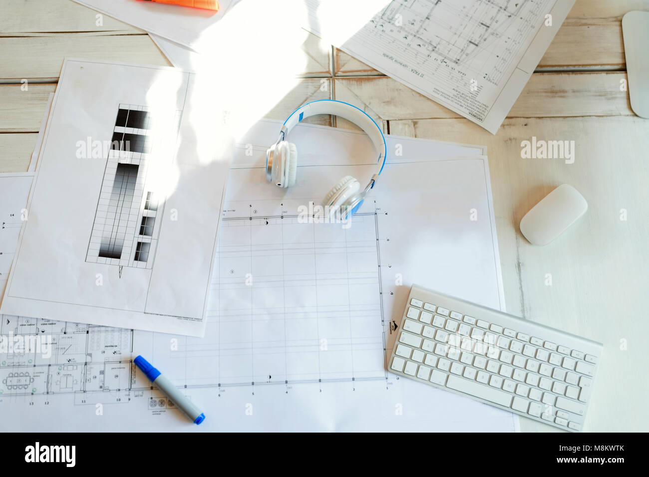Architectural project, blueprints, blueprint rolls on wooden desk table - Stock Image
