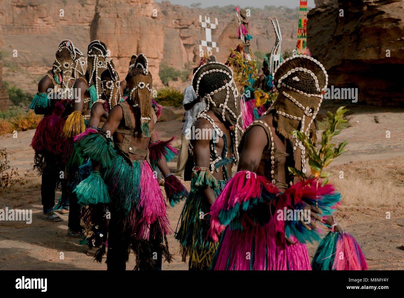 A group of Dogon men performing a ritual tribal masked dance ceremony. Dogon country, Mali, West Africa. - Stock Image