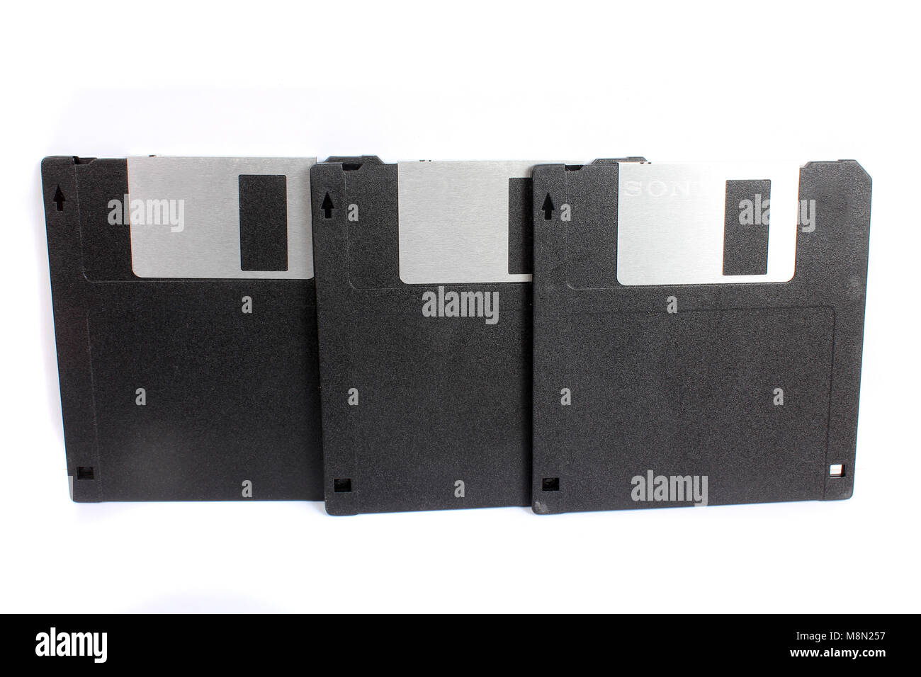 A set of 1.44 MB floppies used for storing data in computers in the 90s. - Stock Image