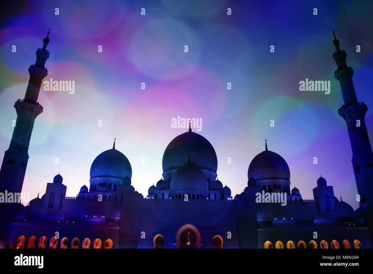 A view of the grandmosque through a thin mesh of colorful light sequins. - Stock Image