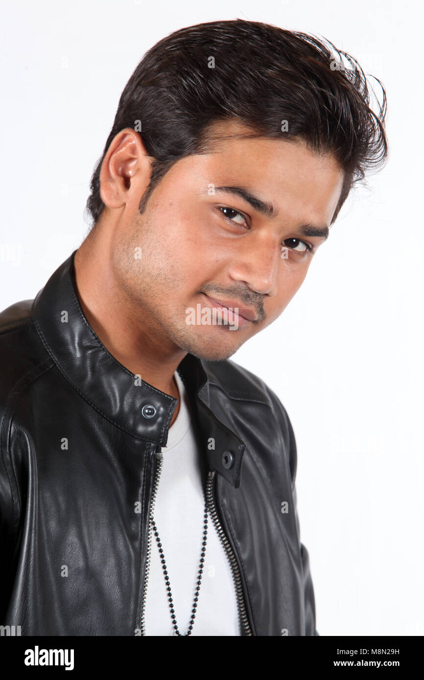 A portrait of a young handsome Indian guy wearing a black leather jacket. - Stock Image