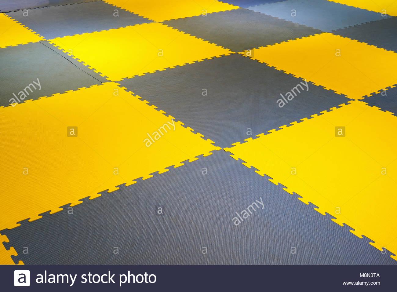 Flooring tiles stock photos flooring tiles stock images alamy ground futsal futsal plastic court flooring tiles texture floor stock image dailygadgetfo Choice Image