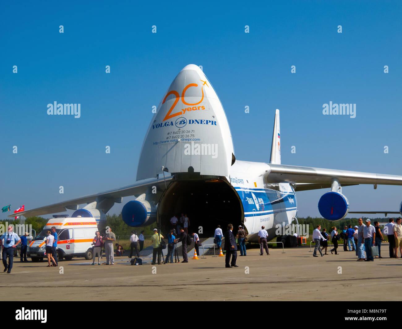 AN-124-100 strategic airlift jet (Condor), Antonov Volga-Dnepr unloading, front ramp down, nose door open. ZHUKOWSKY - Stock Image