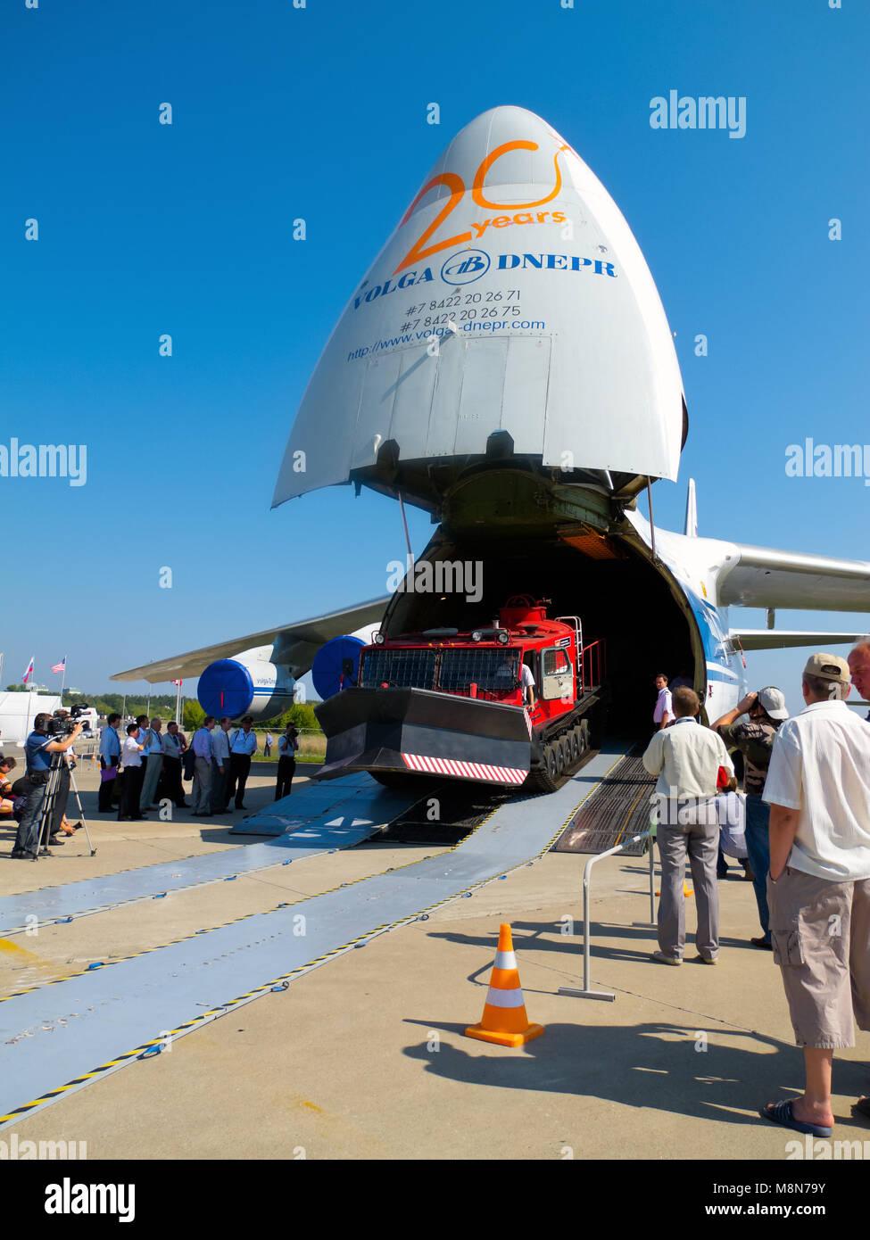 AN 124 100 Antonov Volga Dnepr jet airplane unloading, front ramp down, nose up at International Aviation & - Stock Image