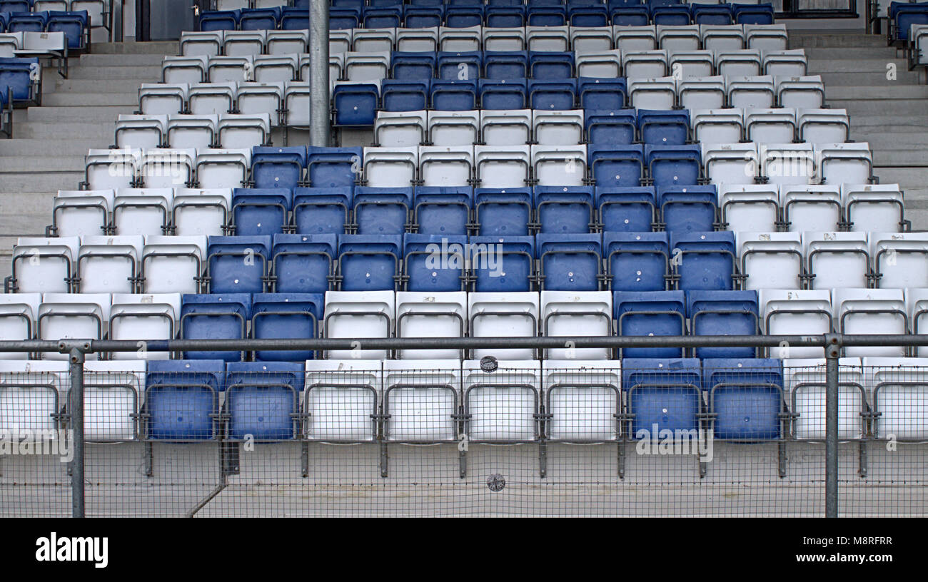 empty-stadium-seats-making-up-the-letter-a-in-blue-and-white-before-M8RFRR.jpg