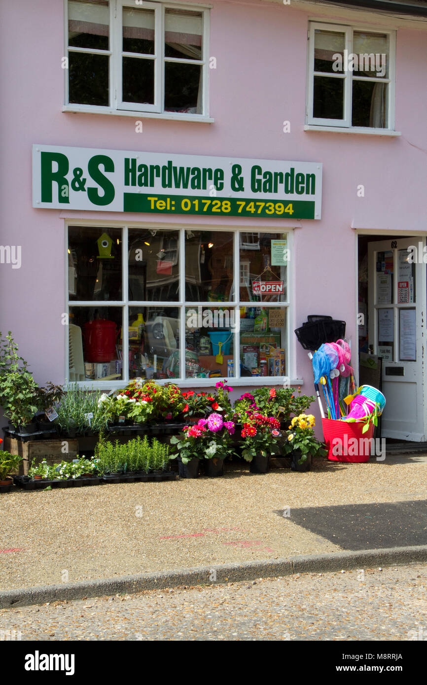 Small town hardware shop with plants outside - Stock Image
