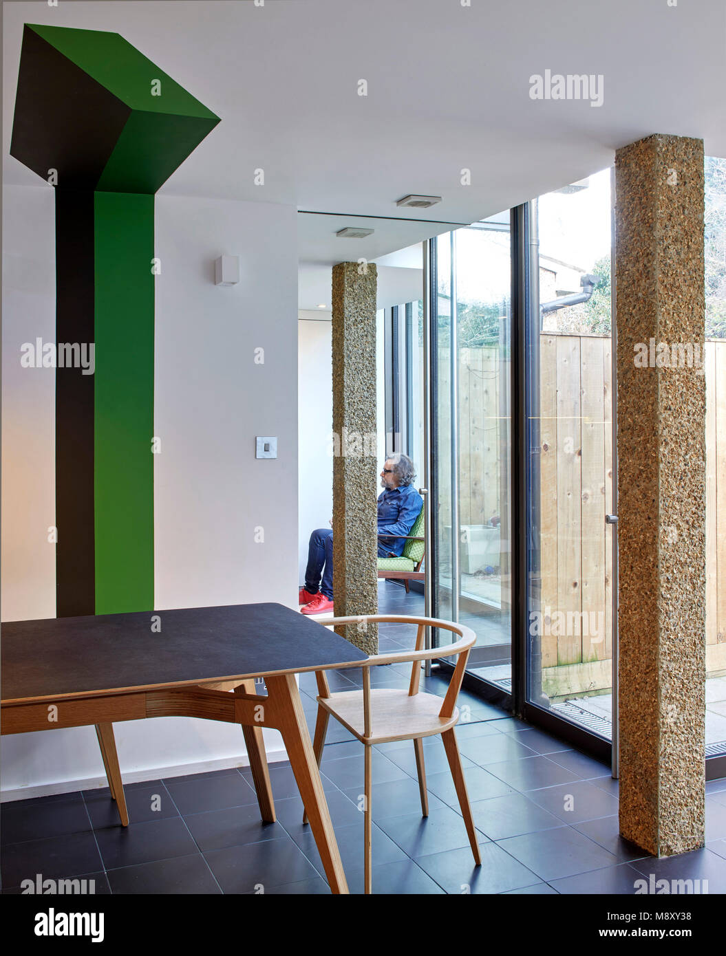Interior view with architect in the mirror. Sean Griffiths, London, United Kingdom. Architect: Sean Griffiths , - Stock Image