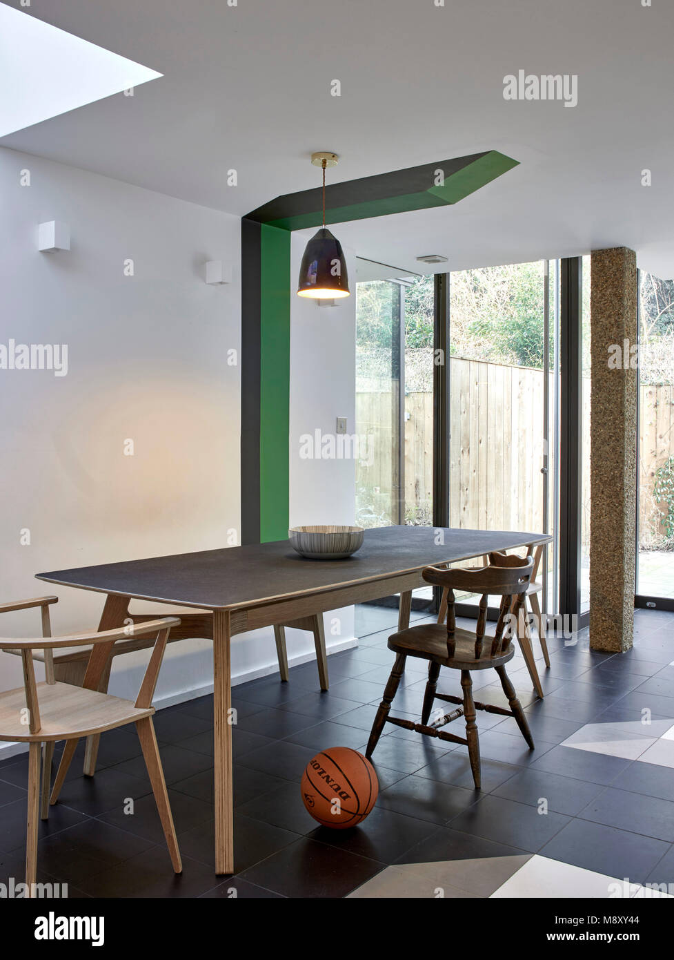 Overall interior view with basketball. Sean Griffiths, London, United Kingdom. Architect: Sean Griffiths , 2018. - Stock Image