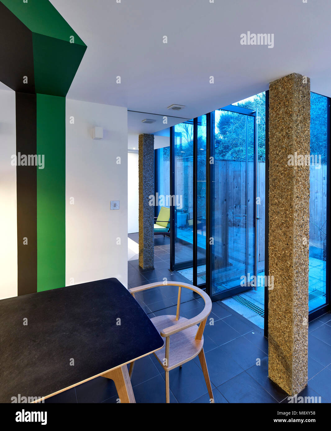 Interior view towards garden. Sean Griffiths, London, United Kingdom. Architect: Sean Griffiths , 2018. - Stock Image