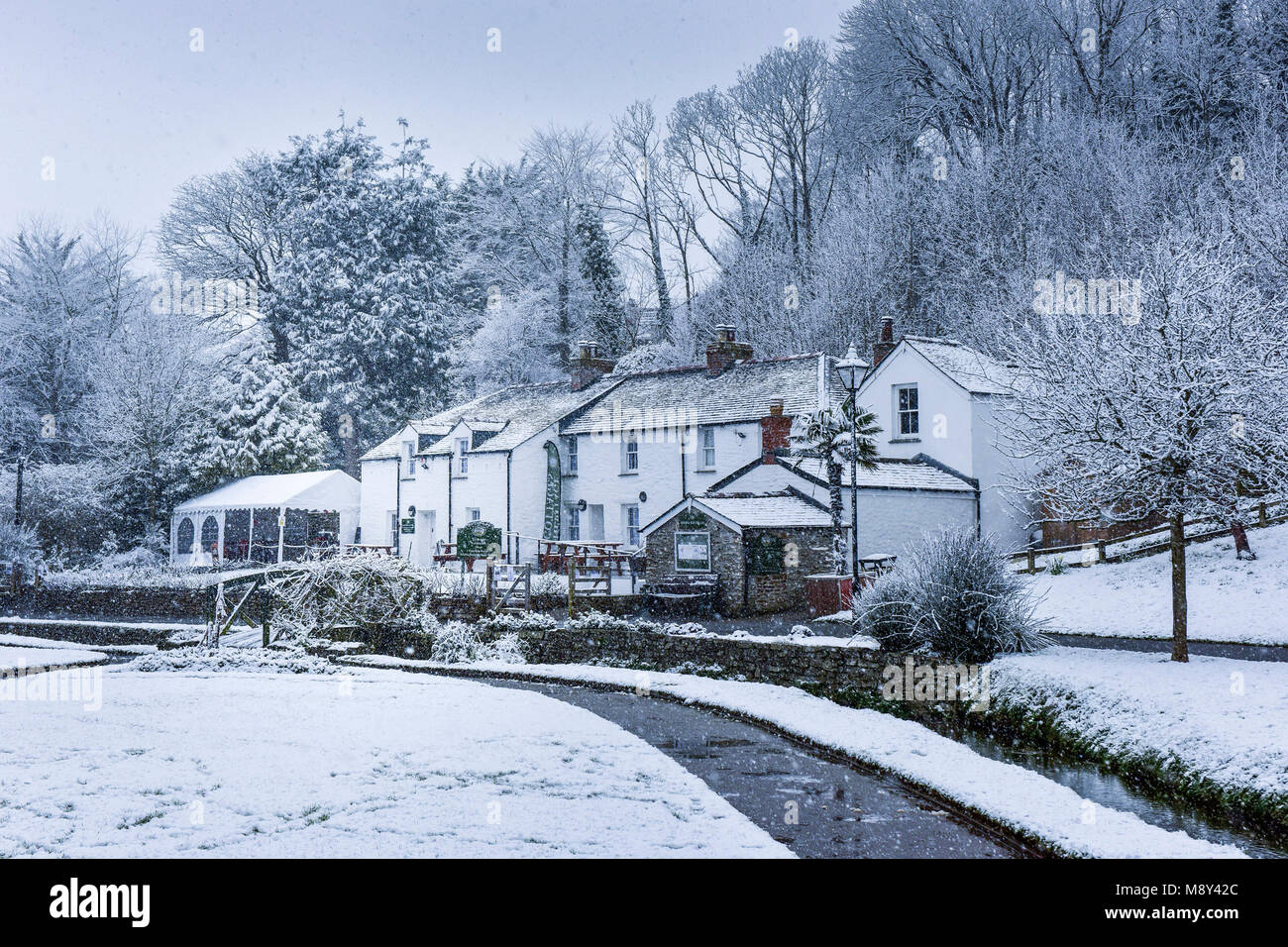 Snowing over the Trenance Heritage Cottages in Trenance Gardens Newquay Cornwall. - Stock Image