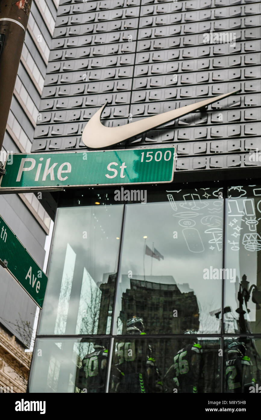Nike's storefront and logo in downtown Seattle - Stock Image