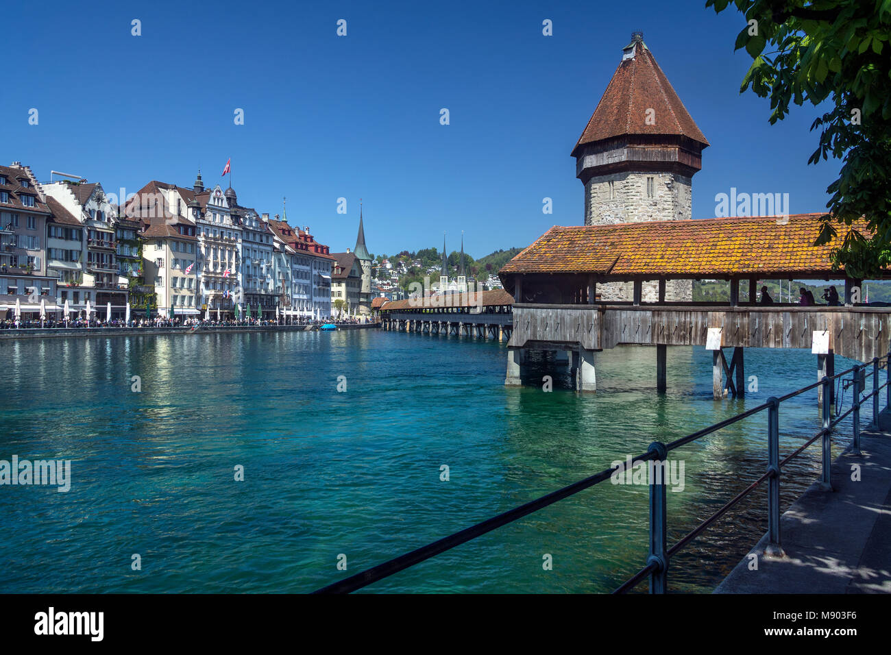 Chapel Bridge - a 14th century covered wooden footbridge that spans the Reuss in the city of Luzern (Lucerne) in - Stock Image