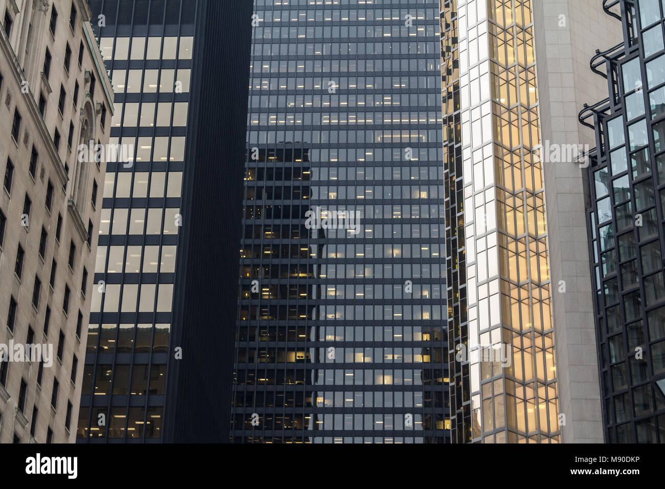 Skyscrapers reflecting in the mirror like windows of another modern high rise in Toronto, Ontario, Canada  Picture - Stock Image