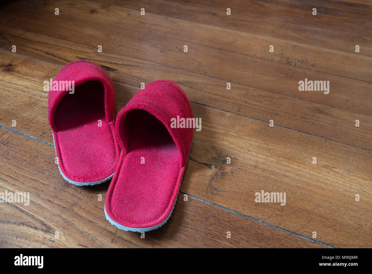 1480aef13b2 A pair of red slippers on a wooden floor Stock Photo  177650279 - Alamy