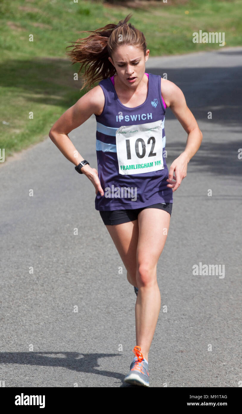 Runners on a country road competing in a 10km race - Stock Image