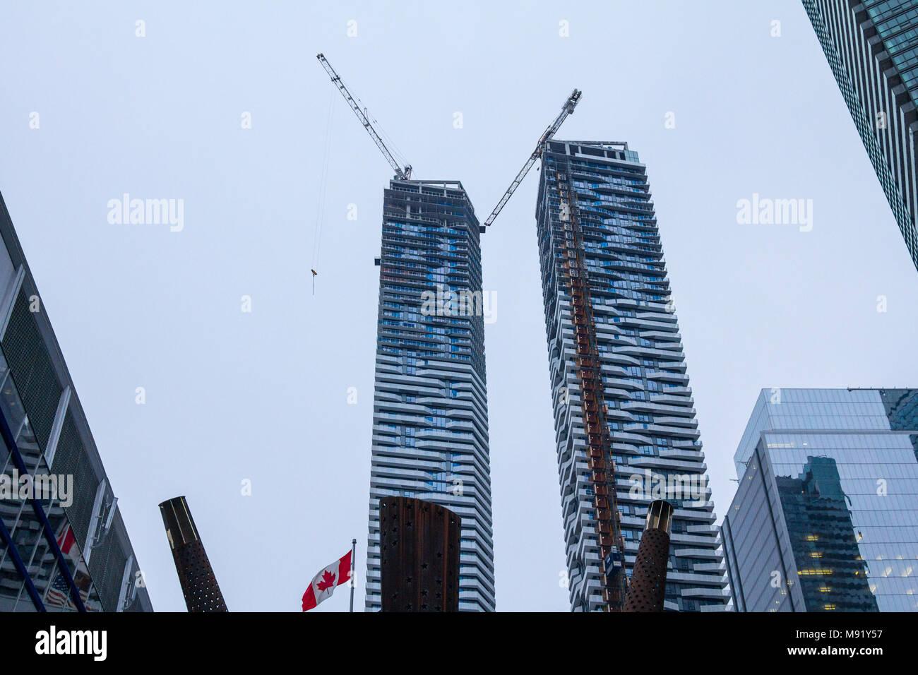 TORONTO, CANADA - DECEMBER 21, 2016: Condo Skyscraper construction site in front of older buildings in downtown Toronto, Ontario, Canada  Picture of C - Stock Image