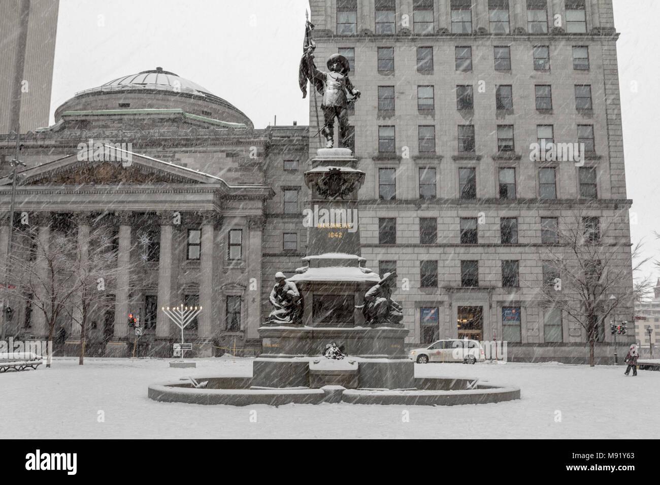 MONTREAL, CANADA - DECEMBER 24, 2016: Maisonneuve monument on place d'Armes square during a snowstorm. It is a monument dedicated to Maisonneuve, the  - Stock Image