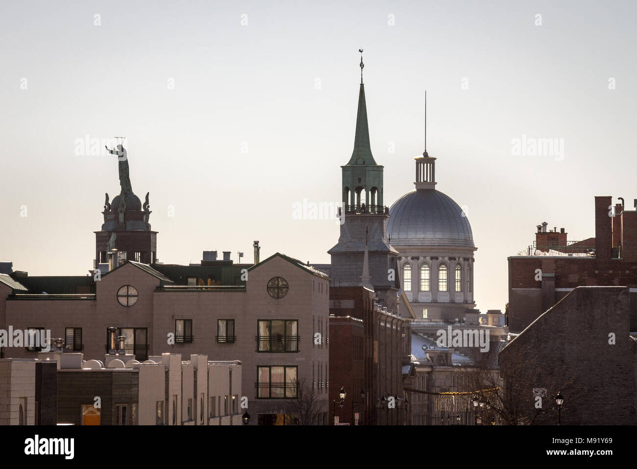Marche Bonsecours in Montreal, Quebec, Canada, into the light during a winter morning, surrounded by other historical buildings. Bonsecours Market is  - Stock Image