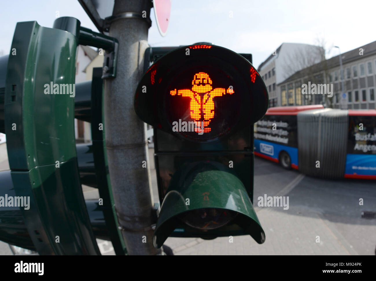 19 March 2018, Germany, Trier: A Karl Marx figure shines on the traffic light. LED technology and stencils were installed for the traffic light close to the soon to be erected Karl Marx statue. Photo: Harald Tittel/dpa Stock Photo