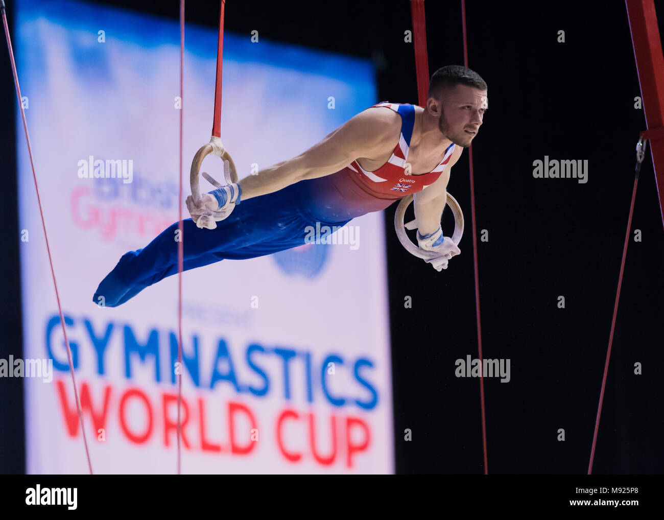 Birmingham, UK. 21st March, 2018. Dominick Gunnigham (GBR) competes on the Still Rings during the 2018 FIG Gymnastics World Cup at Arena Birmingham on Wednesday, 21 March 2018. Birmingham England. Credit: Taka Wu/Alamy Live News - Stock Image