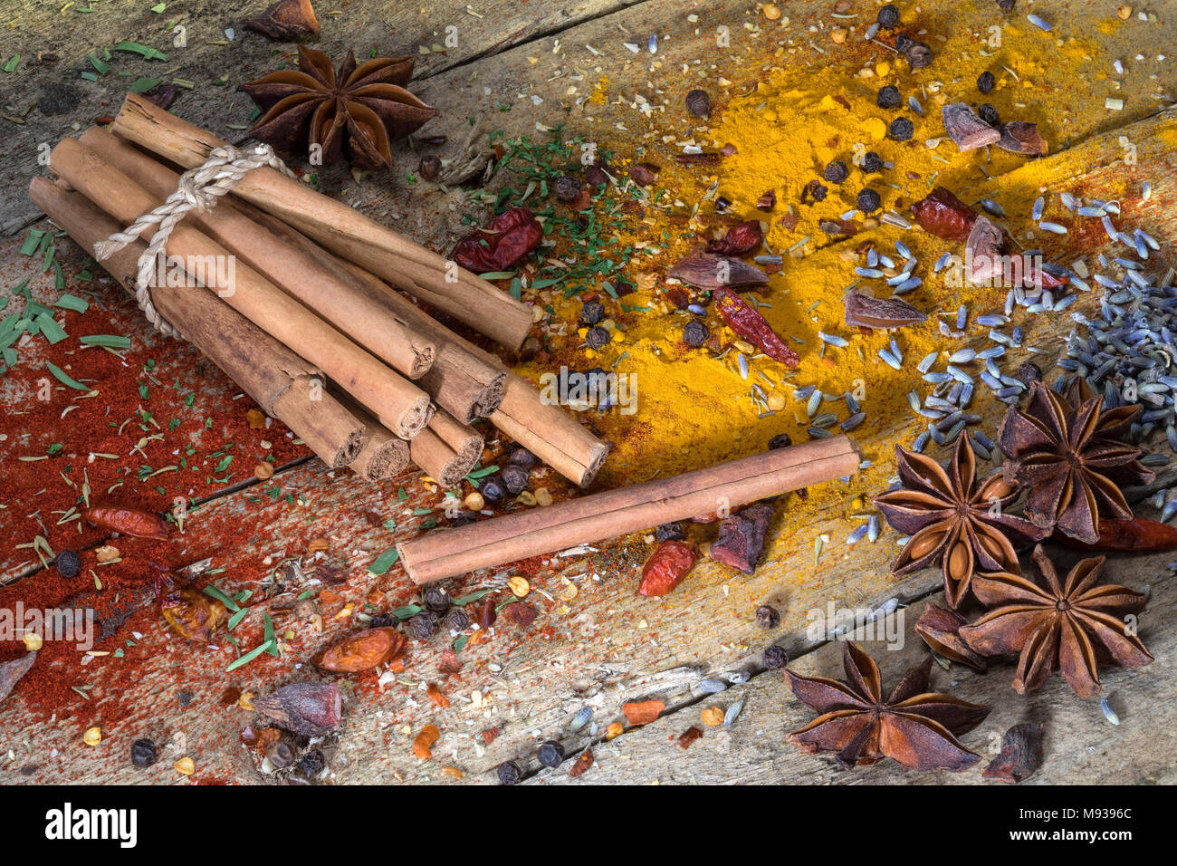 Cinnamon sticks - Herbs and Spices on a rustic farmhouse table. - Stock Image