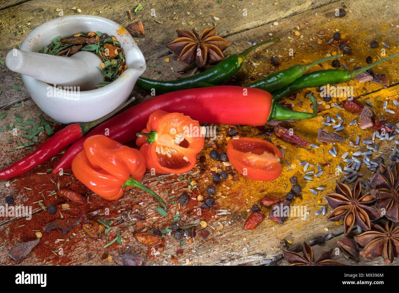 Hot Chili Peppers - Herbs and Spices on a rustic farmhouse table. - Stock Image