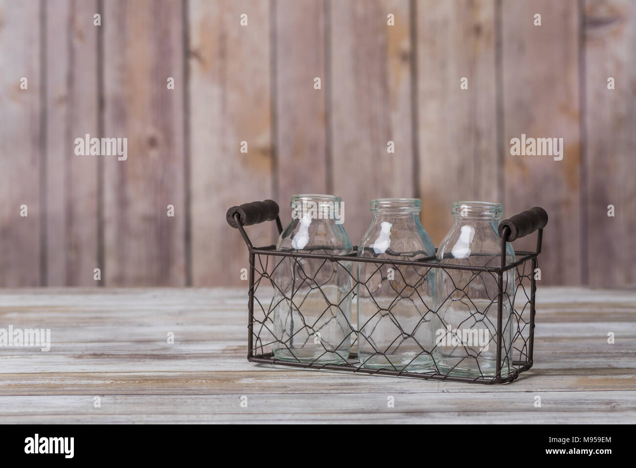 Vintage milk bottles in a wire basket carrier Stock Photo: 177752812 ...