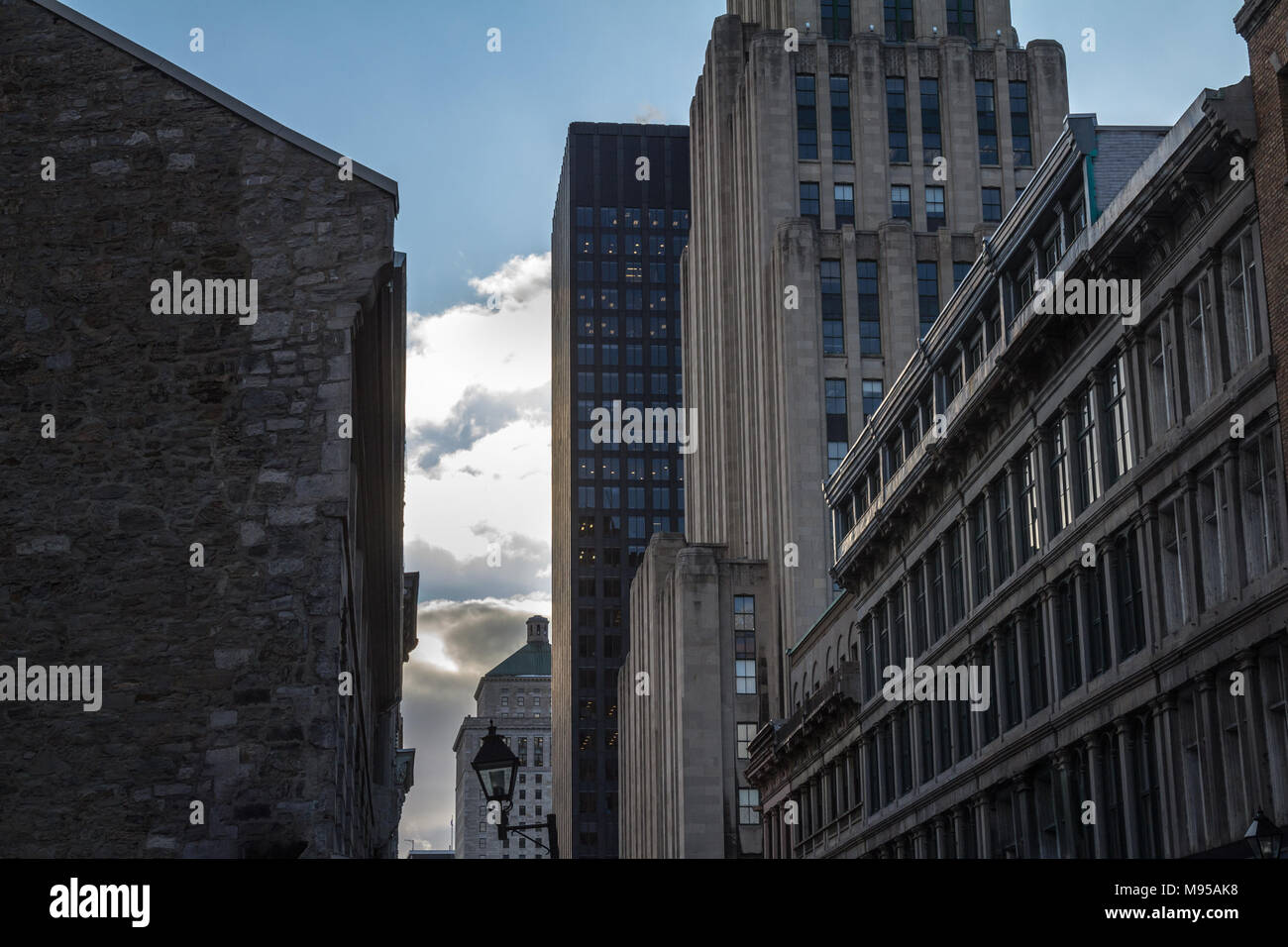Skyscrapers and older buildings in Old Montreal (Vieux Montreal), Quebec, Canada. Old Montreal is one of the oldest parts of North America, and a majo - Stock Image