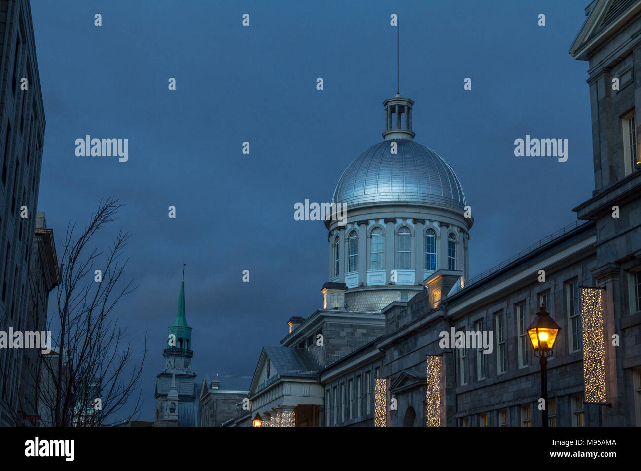 Marche Bonsecours in Montreal, Quebec, Canada, during a winter evening, surrounded by other historical buildings. Bonsecours Market is one of the main - Stock Image