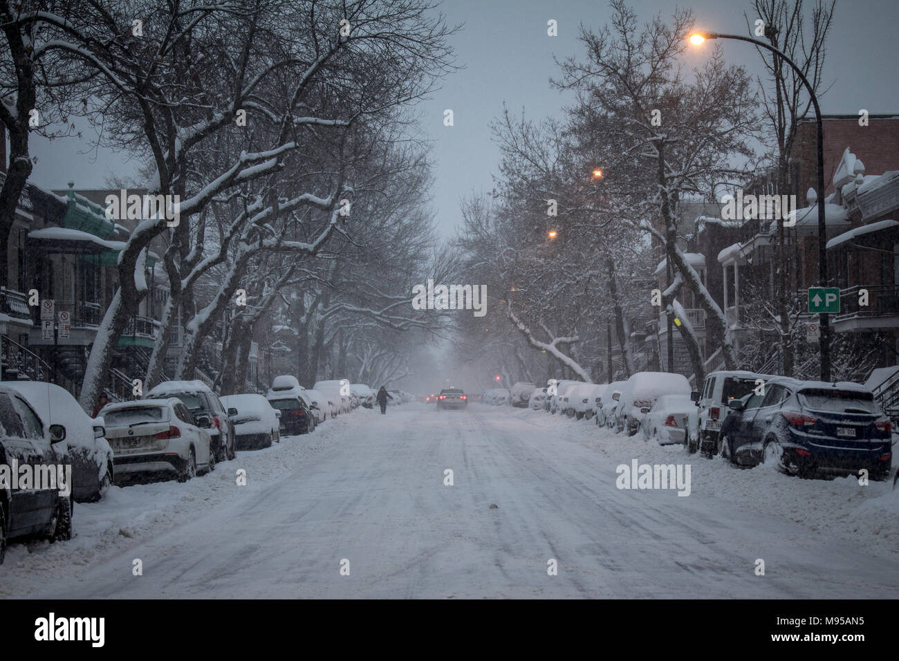 MONTREAL, CANADA - DECEMBER 29, 2016: Typical North American residential  street covered in snow in a residential suburban part of Montreal, Quebec, C - Stock Image