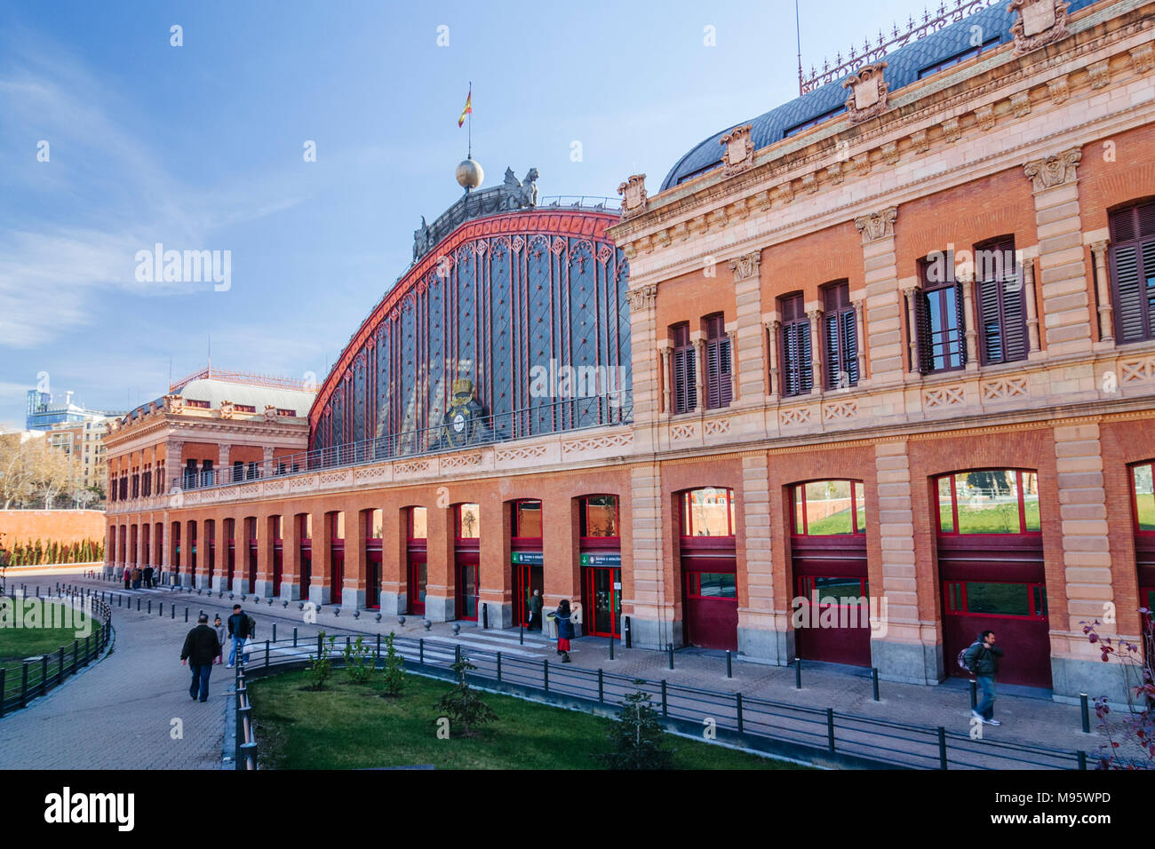 Madrid, Spain : Front view of Atocha train Station at Plaza del Emperador Carlos V (Emperor Charles V Square) inaugurated on 9 February 1851. - Stock Image
