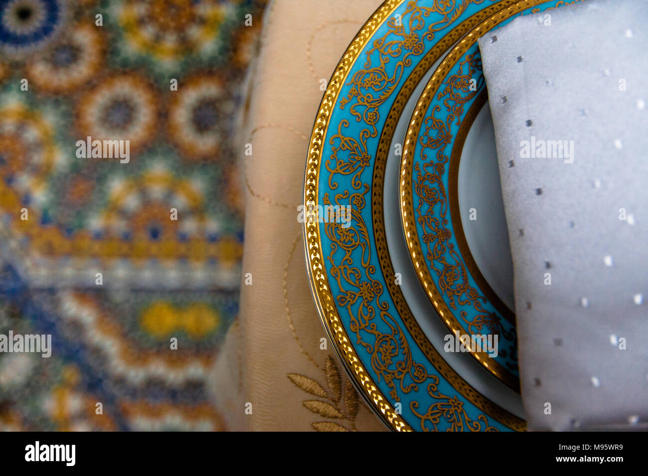 A Closeup Of Table Setting In Muslim Restaurant, Tablecloth, Plates And  Napkin All With Arabic Design, Morocco.