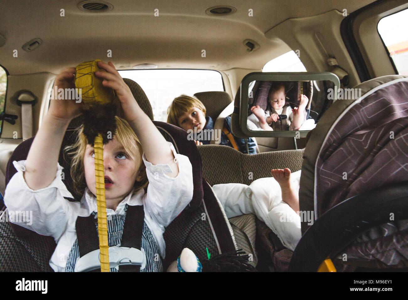 Children sitting in van - Stock Image
