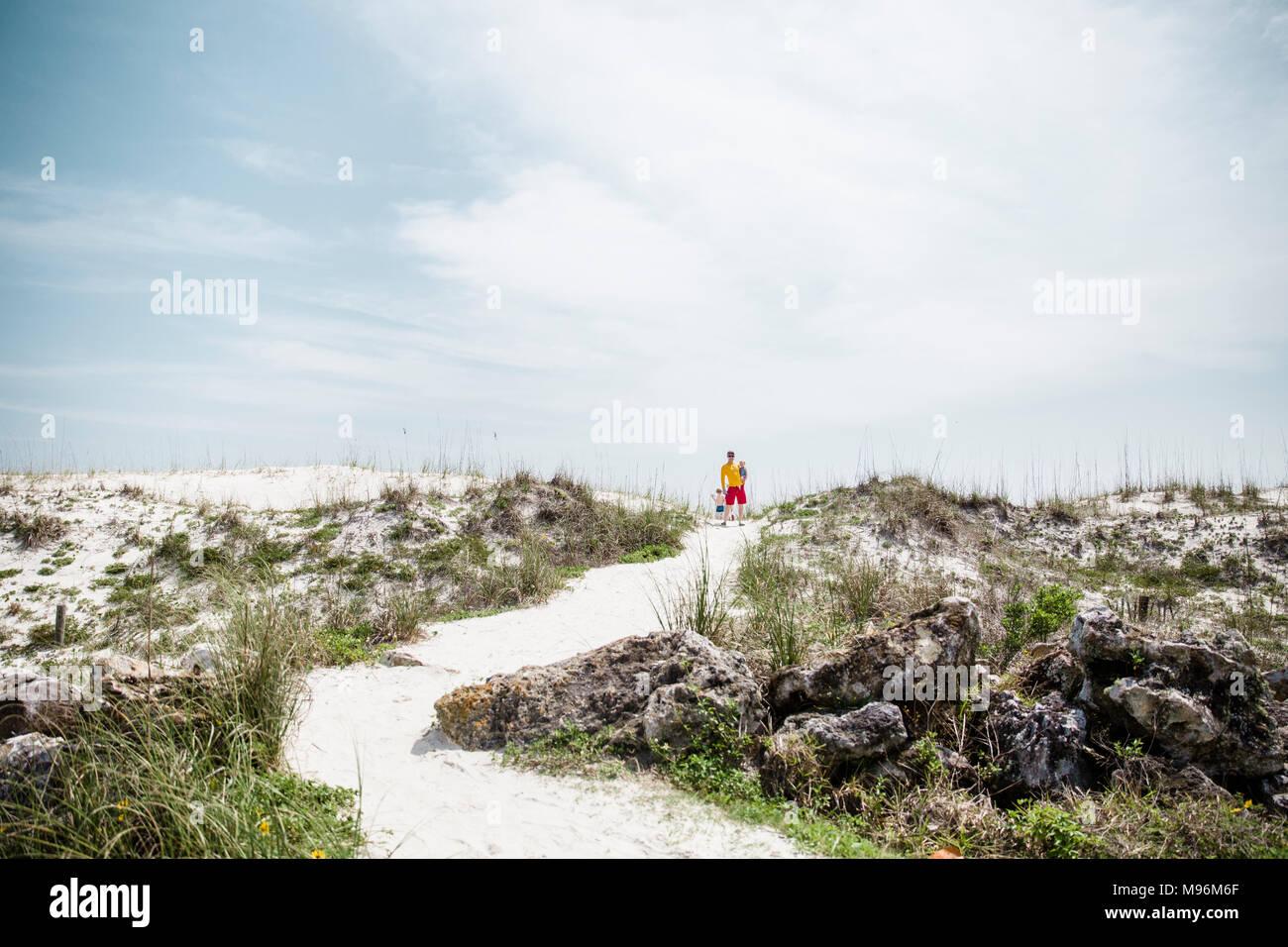 Family walking around the beach - Stock Image