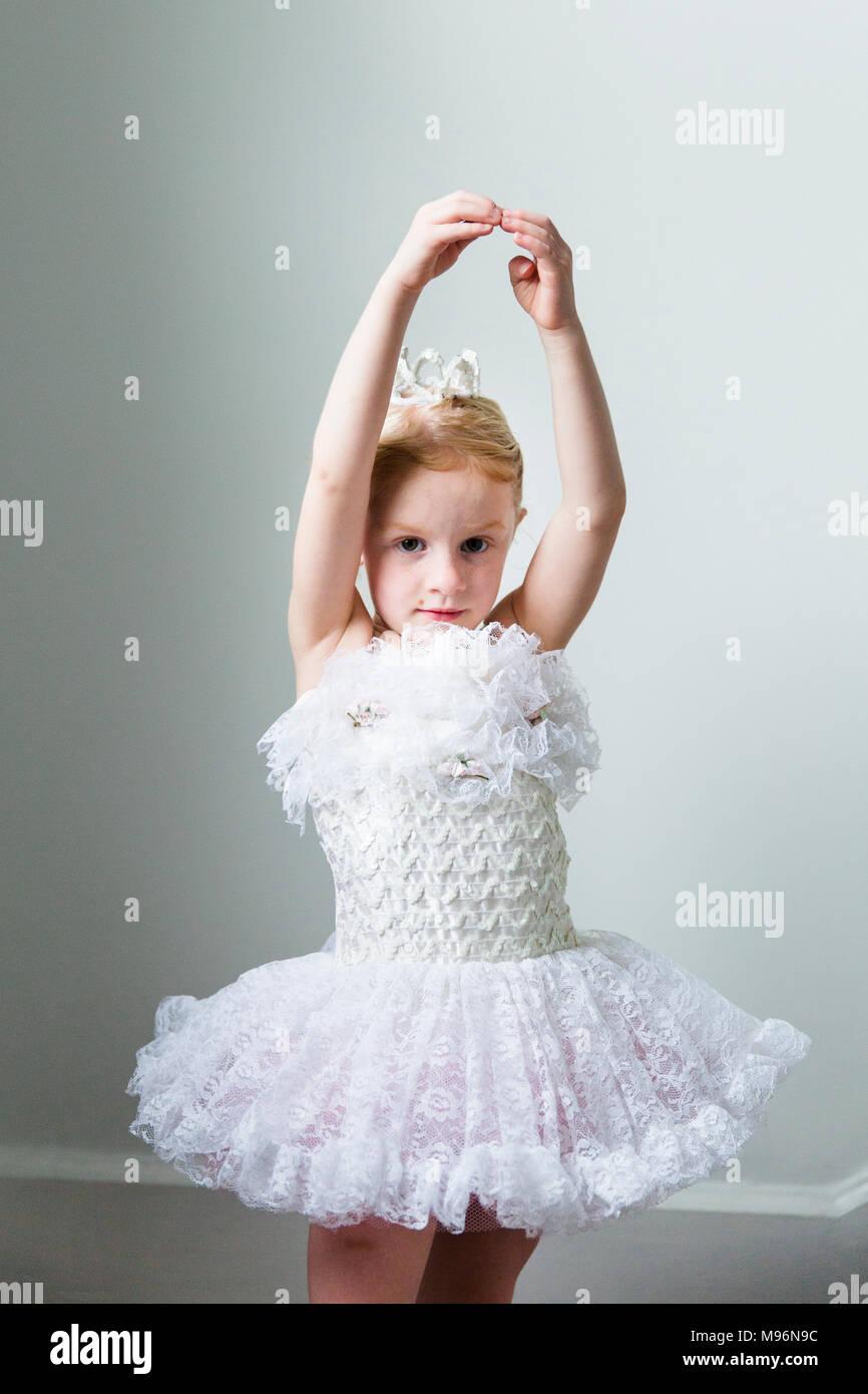 Ballerina girl in white dress - Stock Image