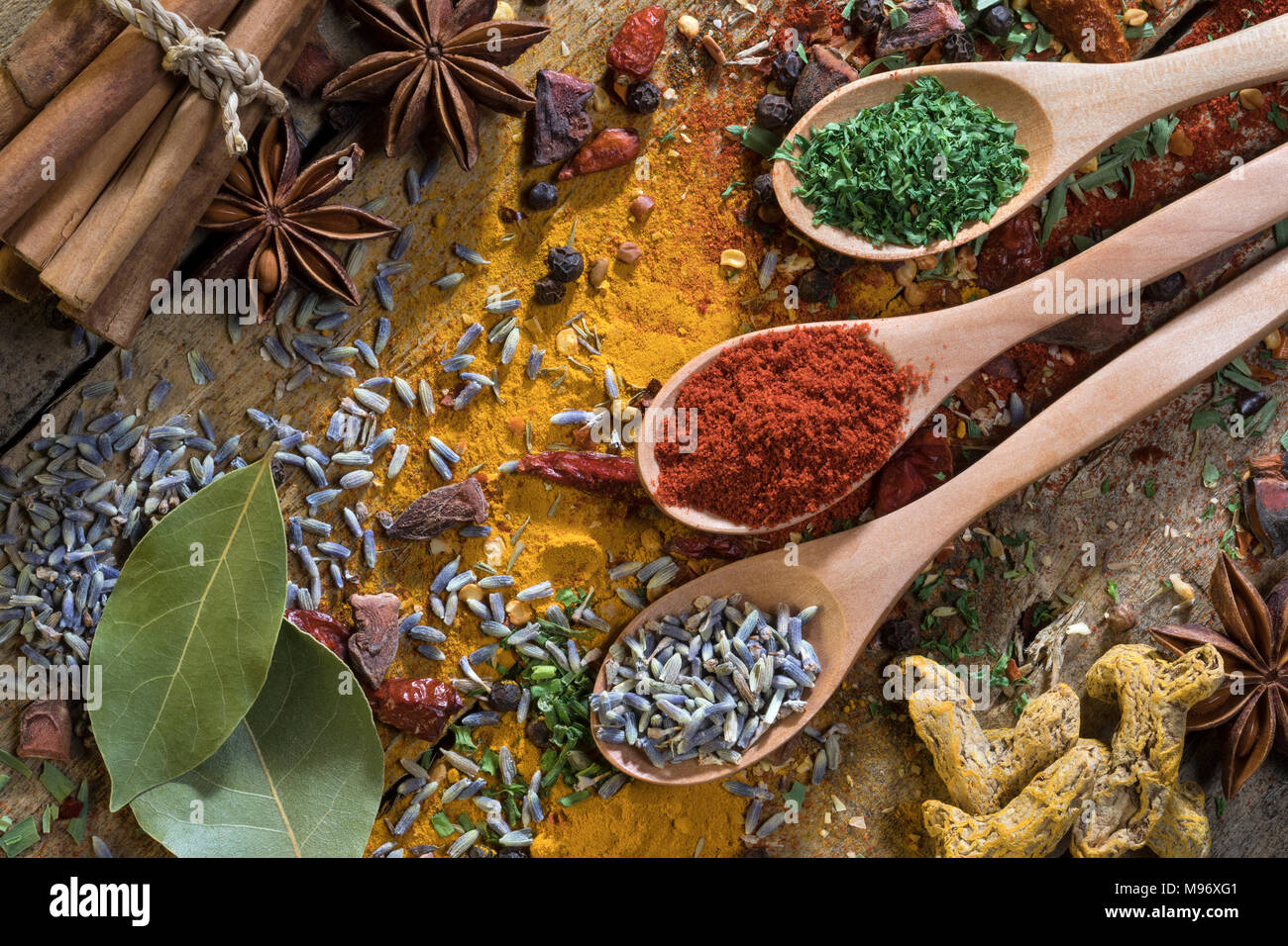 Herbs and Spices on a rustic farmhouse table. Used to add flavor and seasoning to cooking. - Stock Image