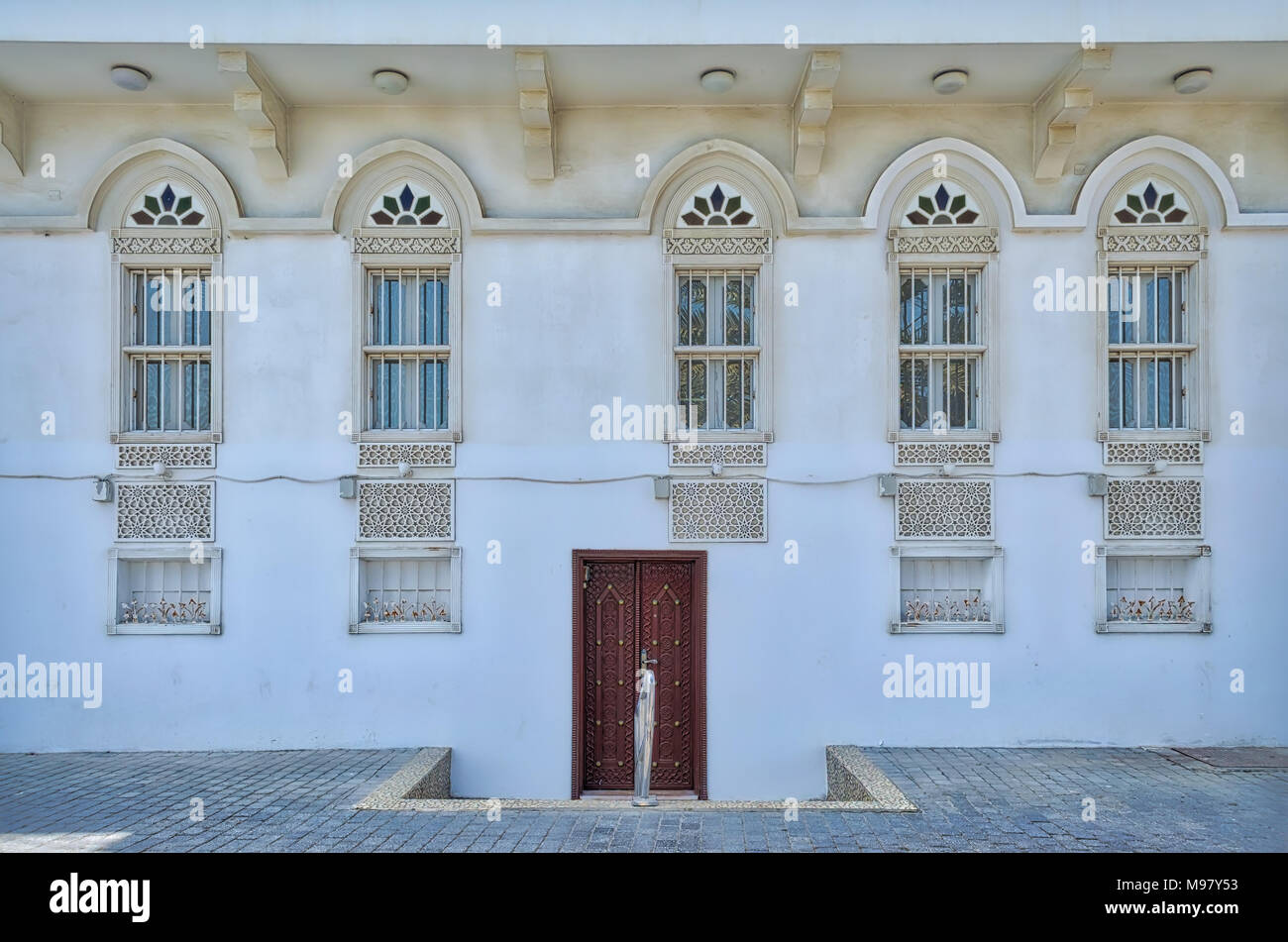 Old, traditional, arabic style windows and door in the front of house - Muscat, Oman. Stock Photo