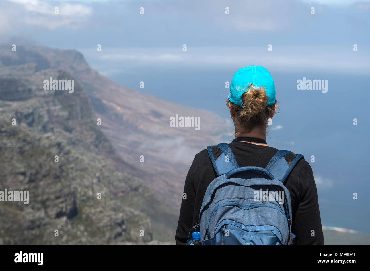 Female hiker admiring the view from the top of Table Mountain in Cape Town, South Africa - Stock Image