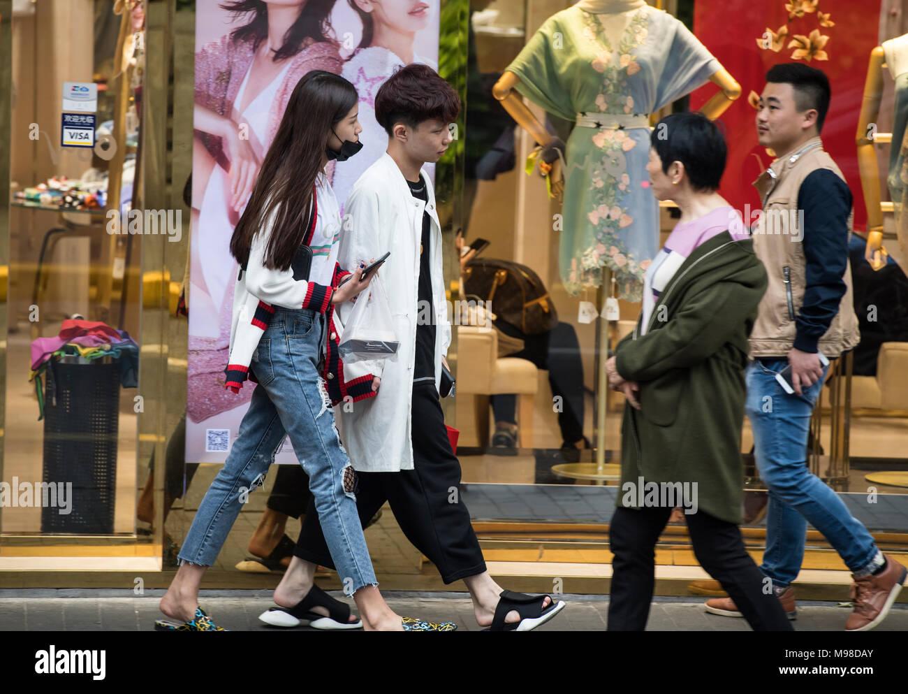 People walking along a main shopping street in Shanghai, China - Stock Image