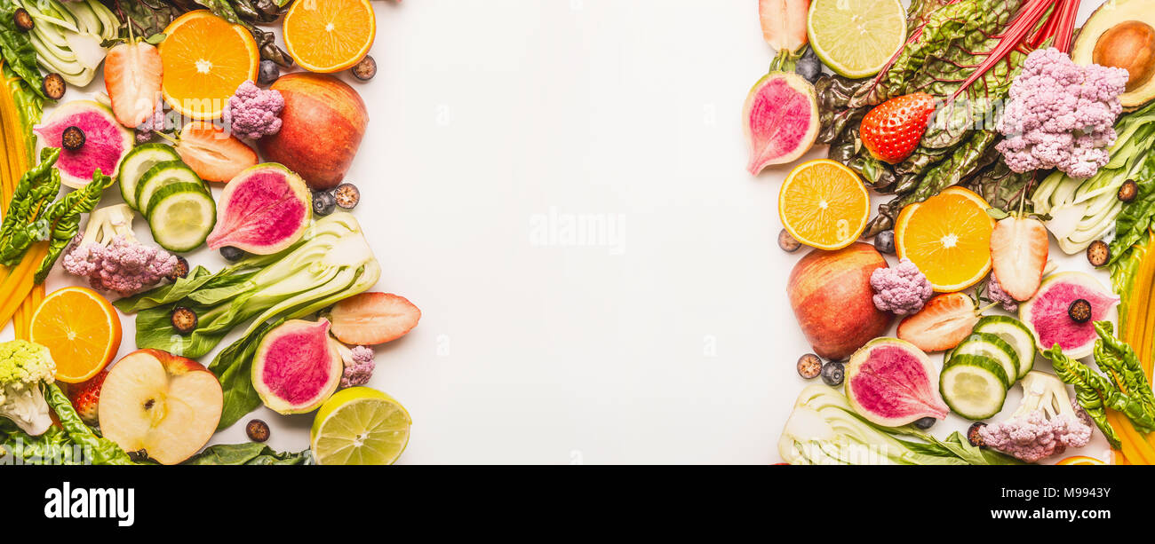 colorful fruits and vegetables background with half of oranges and