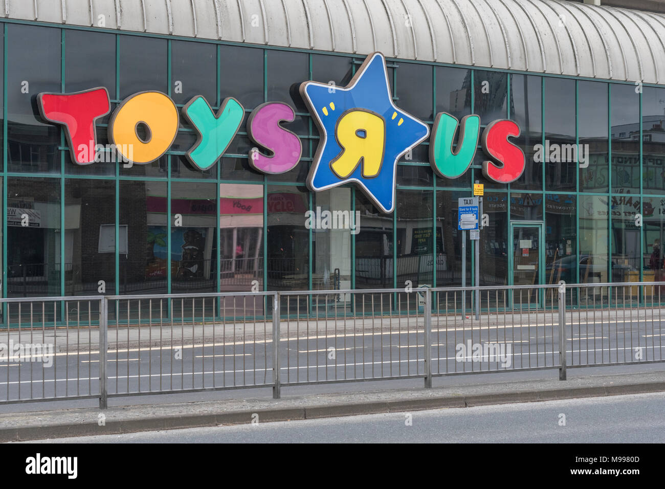 Front of the closed Toys R Us shop in Plymouth, Devon. Metaphor for high street retail casualties. Death of the high street metaphor. - Stock Image