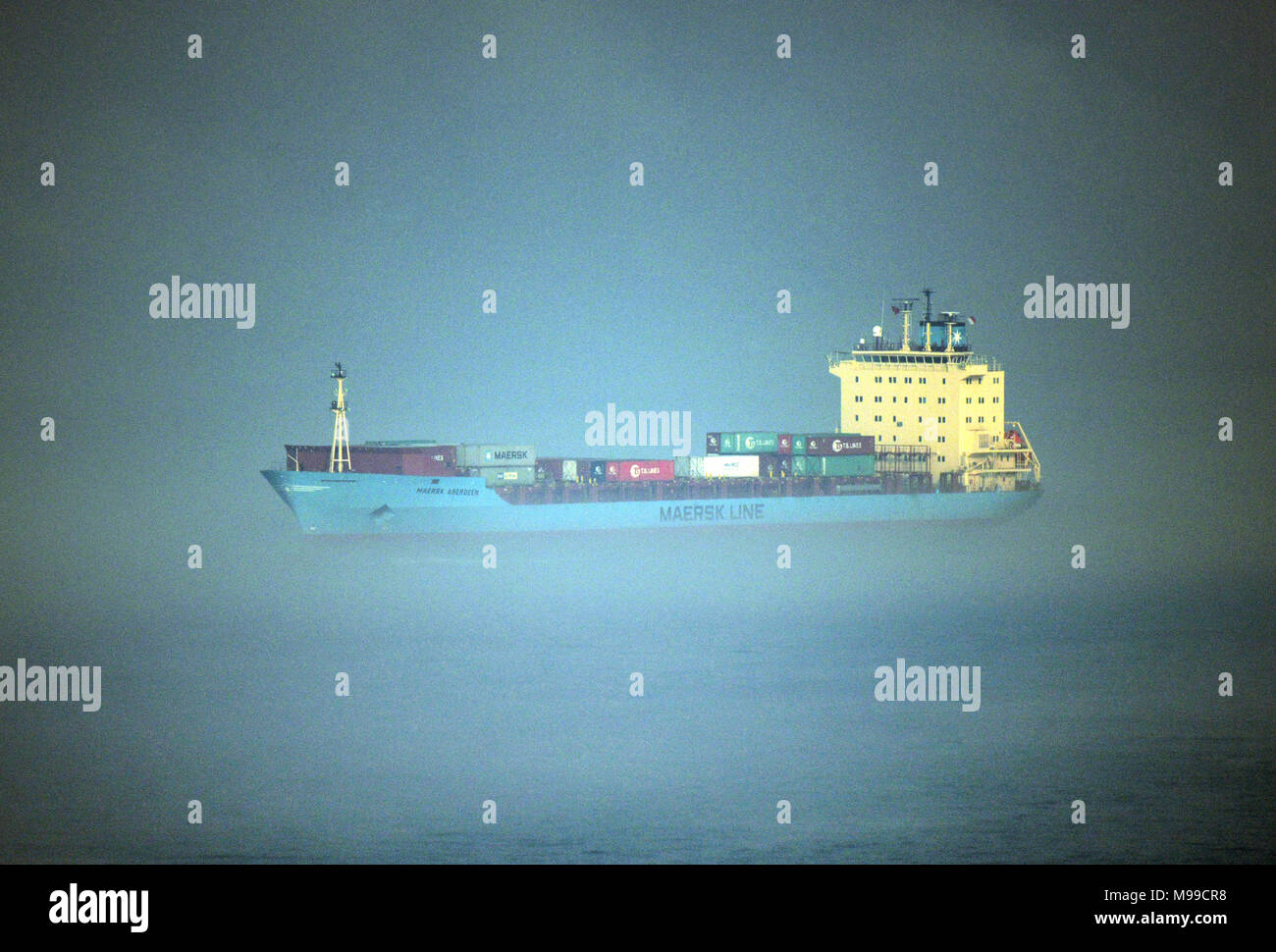 A MAERSK container ship in the fog. - Stock Image