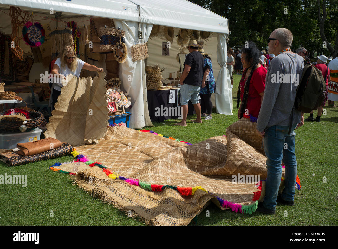 Fine mats brought out to show a potential purchaser at Pasifica, Pacific Island Festival, Auckland. - Stock Image