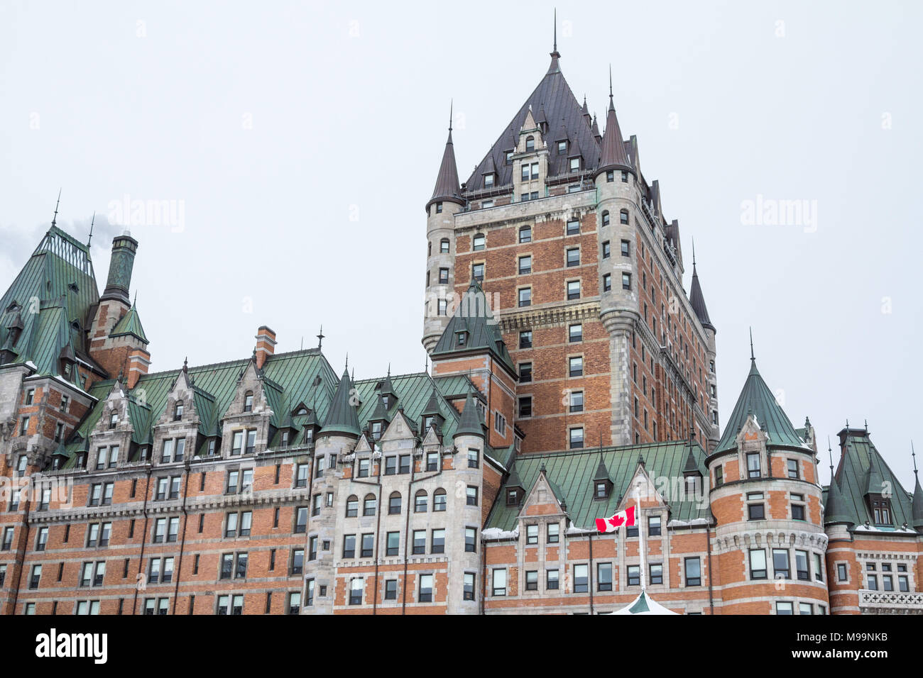 View of Frontenac Castel (Chateau de Frontenac, in French) in winter under the snow. The Château Frontenac is a grand hotel in Quebec City  Picture of - Stock Image
