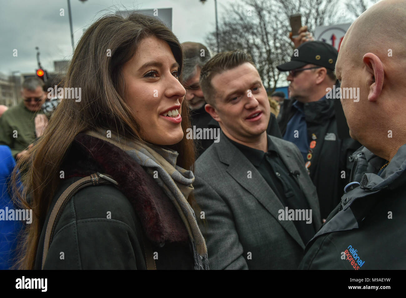 Birmingham, United Kingdom. 24 March 2018. People have gathered for the 'Football Lads Alliance' (FLA) demonstration in Birmingham. There were speeches from John Mieghan, Anne Marie Waters, Luke Nash-Jones and Aline Moraes. After a short march the group dispersed in Edgbaston St. Pictured: Aline Moraes & Tommy Robinson  Credit: Peter Manning/Alamy Live News - Stock Image
