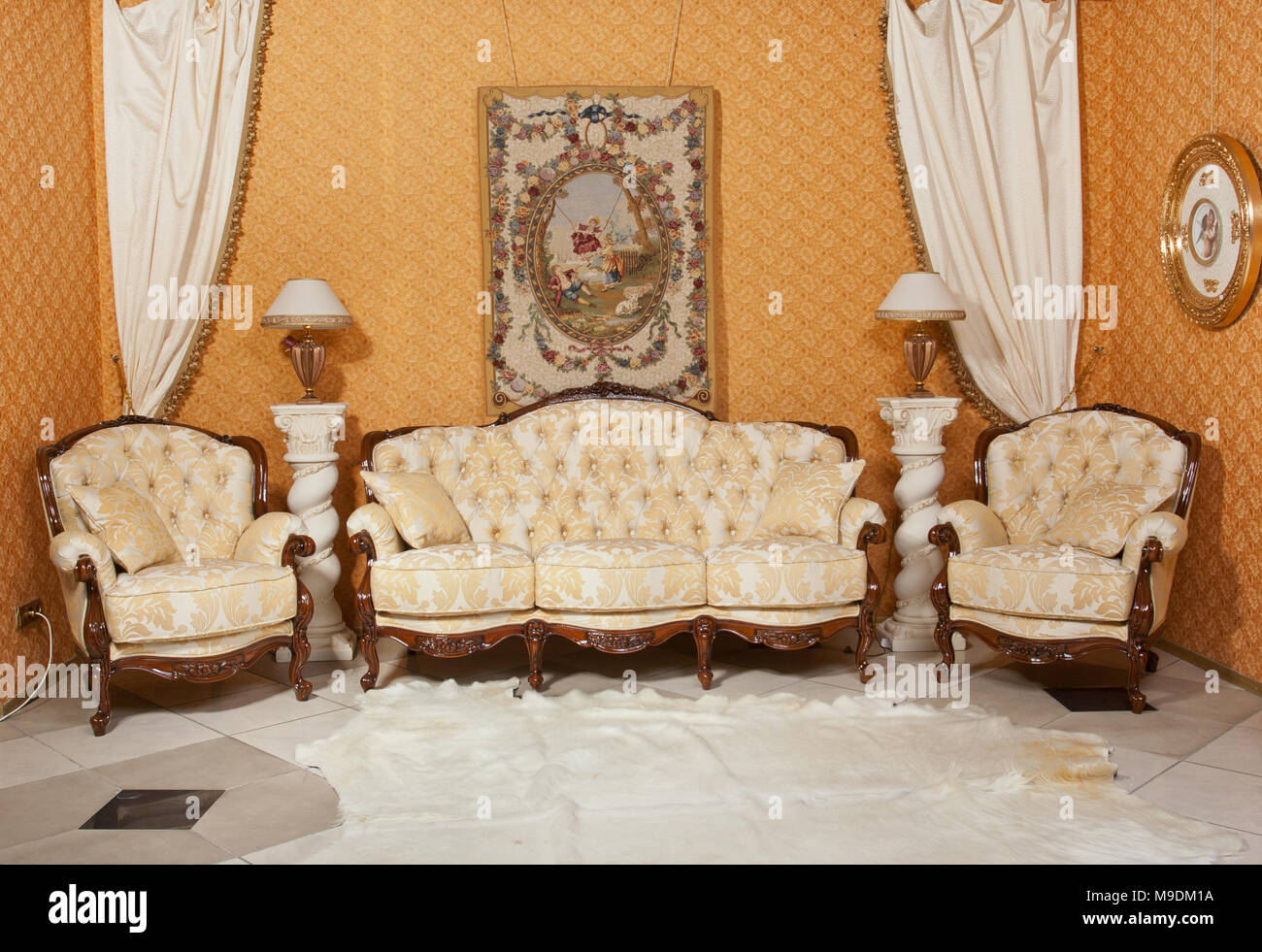 Empty interior living room background in warm colors decorated with classic furniture sofa and chairs