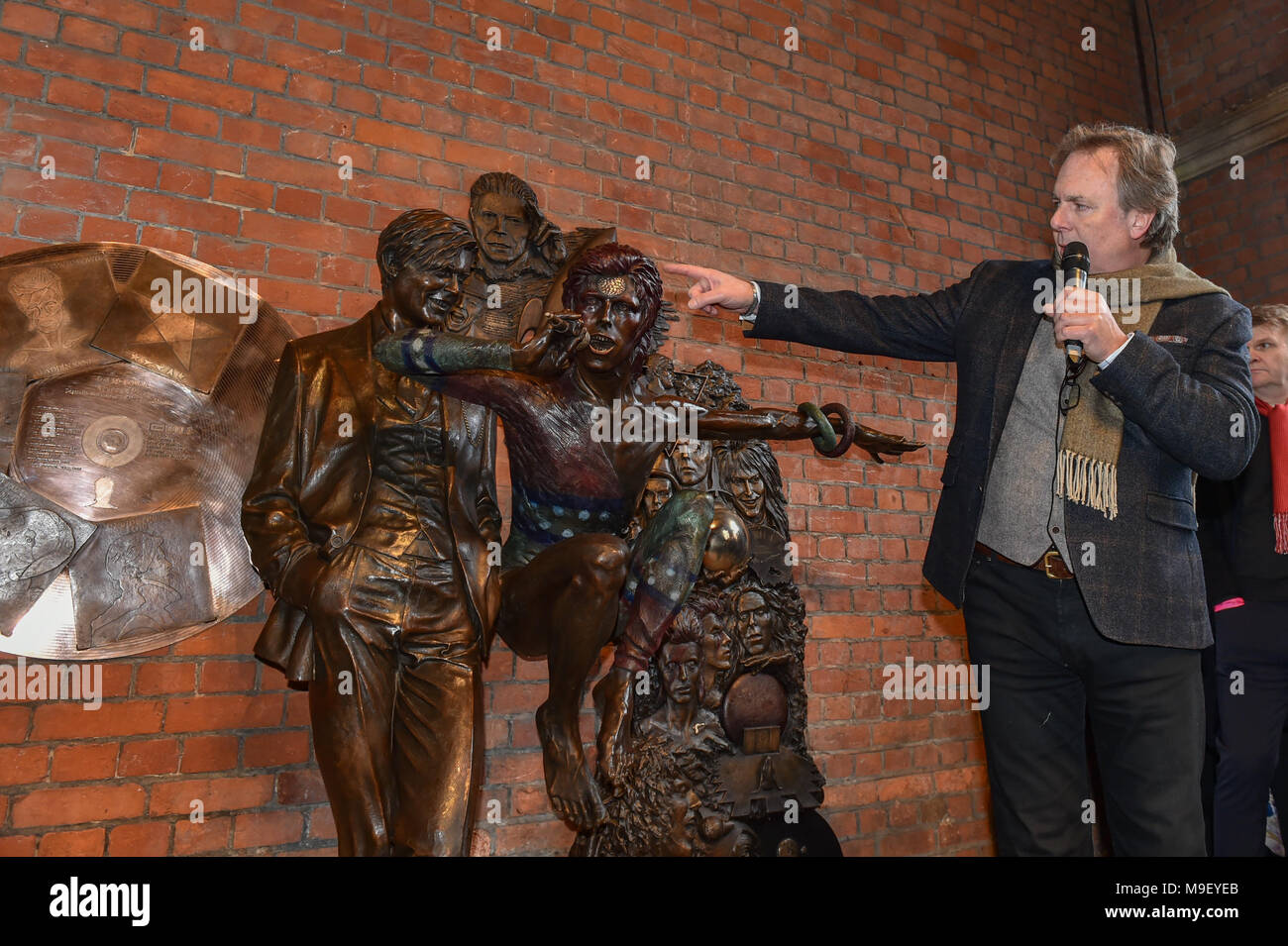 Aylesbury, United Kingdom. 25 March 2018. A David Bowie statue has been unveiled in Aylesbury. The statue was conceived by David Stopps who raised the £100,000 to complete the project. The sculptor, Andrew Sinclair, was also at the unveiling. Pictured: Andrew Sinclair  Credit: Peter Manning/Alamy Live News - Stock Image
