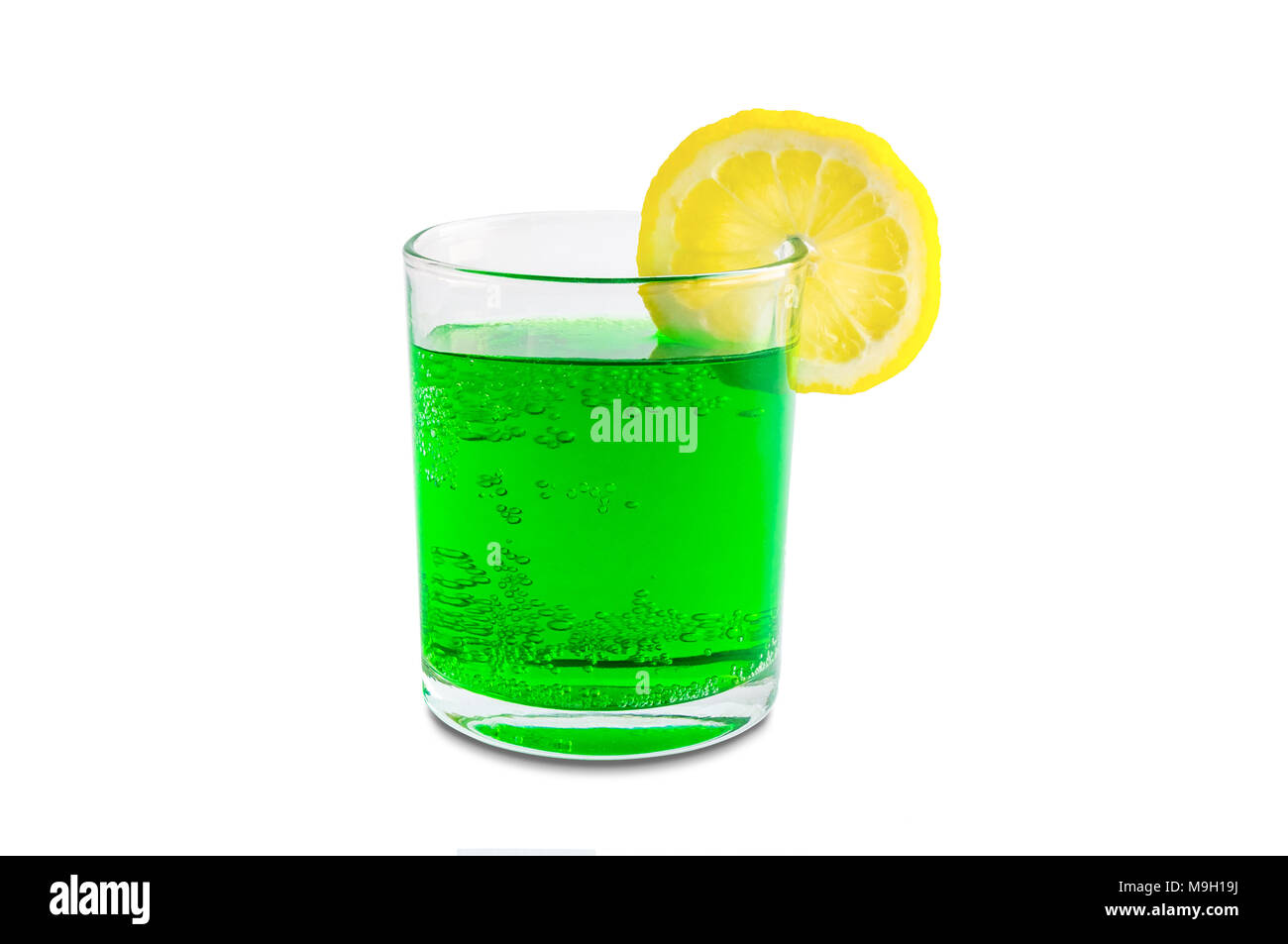 Coconut Green Soda With Lemon On The Edge Of A Transparent Glass And Minty Aroma Spring Summer Isolated White Background