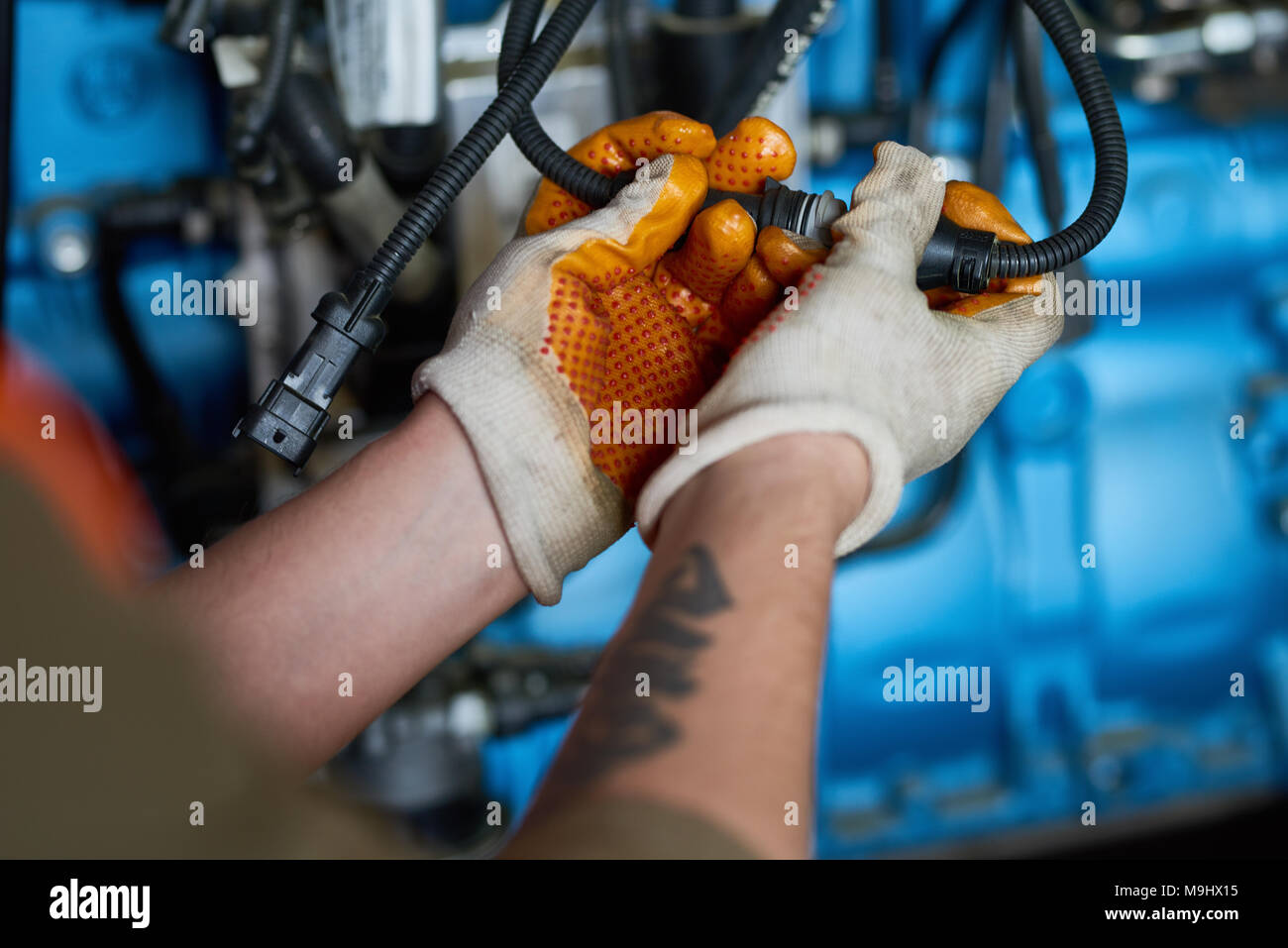 Electrician Connecting Cables - Stock Image